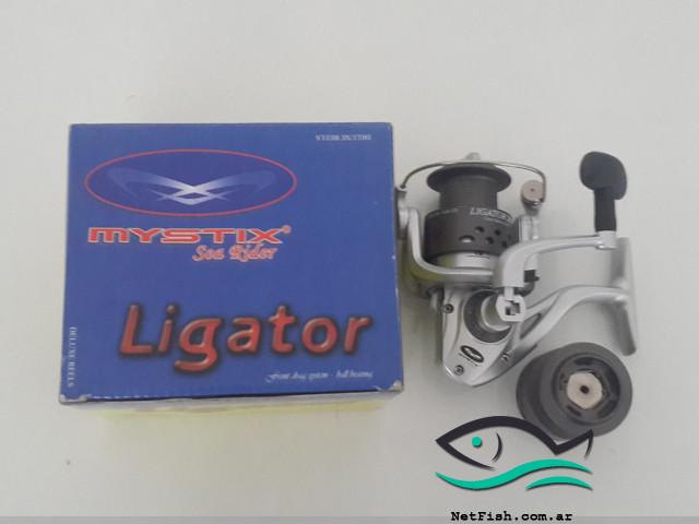 Combo: Reel Ligator Mystix 3000 + Caña de pescar Surfish Spinning 210